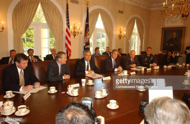 President George W Bush meets with his National Security Advisors in the White House's Cabinet Room, Washington DC, September 12, 2001. They were...