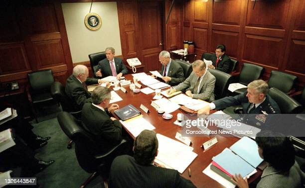 President George W Bush meets with members of the National Security Council meeting in the White House's Situation Room, Washington DC, October 12,...