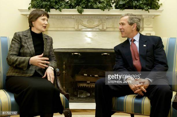 President George W. Bush meets with New Zealand's Prime Minister Helen Clark in the Oval Office of the White House in Washington, DC 26 March 2002....