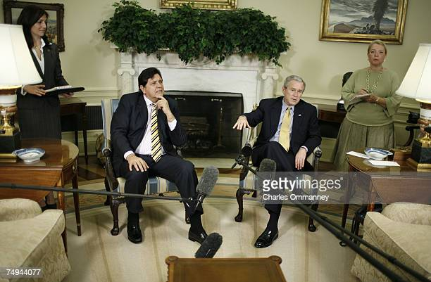 S President George W Bush meets with Peru's President Alan Garcia in the Oval Office at the White House April 23 2007 in Washington DC Garcia was...