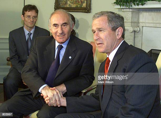President George W Bush meets with President Fernando de la Rua of Argentina in the Oval Office of the White House April 16 2001 In Washington DC
