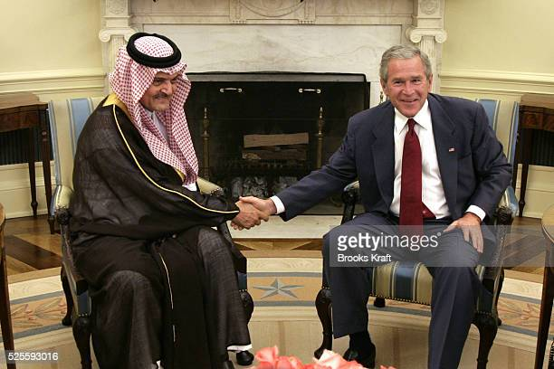 US President George W Bush meets with Saudi Foreign Minister Prince Saud alFaisal in the Oval Office of the White House in Washington July 23 2006