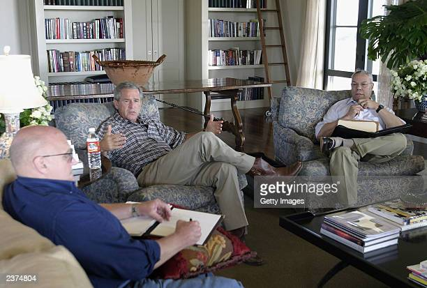 S President George W Bush meets with Secretary of State Colin Powell and Deputy Secretary of State Richard Armitage at his ranch August 6 2003 in...