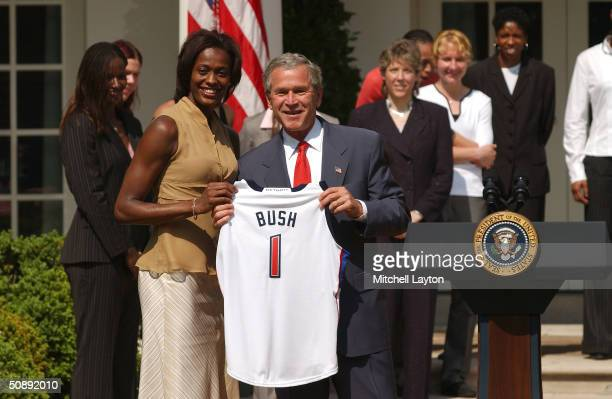 President George W Bush meets with the 2003 WNBA World Champions Detroit Shock in The Rose Garden at the White House May 24 2004 in Washington DC...