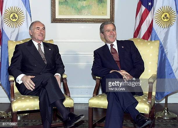 President George W. Bush meets with the President of Argentina Fernando de la Rua 11 November, 2001 at the Waldorf-Astoria Hotel in New York on the...