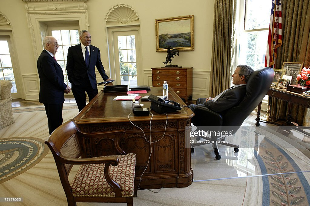 george bush oval office. US President George W. Bush Meets With Secretary Of State General Colin Powell And Oval Office C