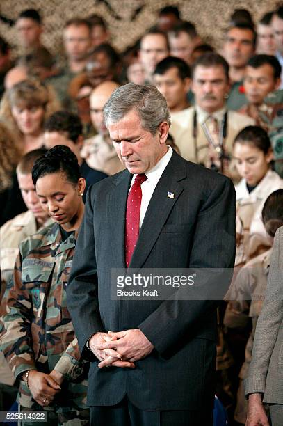 President George W. Bush participates in a short prayer before speaking to the military community at McDill Air Force Base, home of the United States...