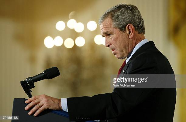 S President George W Bush pauses as he answers a question about the midterm election results during a news conference in the East Room of the White...