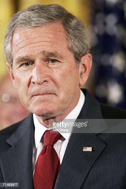 President George W. Bush pauses as he speaks during an East Room event on stem cell research policy July 19, 2006 at the White House in Washington,...