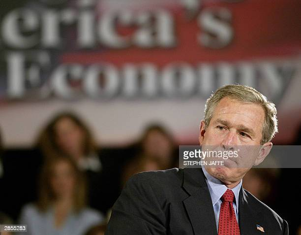 President George W Bush pauses during a conversation with 'Women Small Business Owners' during an event at the US Department of Commerce 09 January...