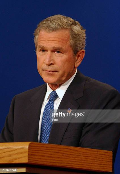 President George W. Bush pauses during the debate with Democratic rival John Kerry on the campus of the University of Miami, Septemberr 30,2004 in...