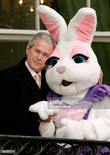 S President George W Bush pauses to embrace a person dressed as the Easter Bunny during the annual Easter Egg Roll on the South Lawn of the White...