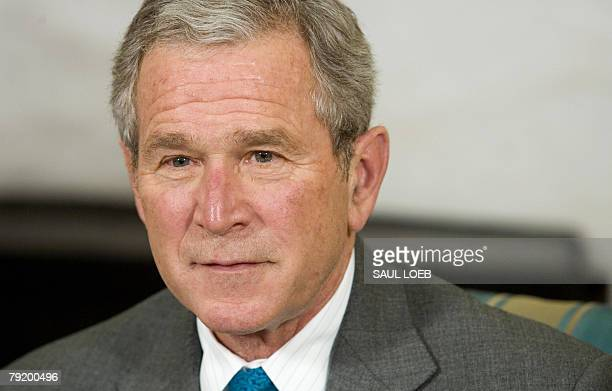 US President George W Bush pauses while speaking during a meeting with Elsa Morejon wife of Presidential Medal of Freedom recipient Oscar Biscet in...