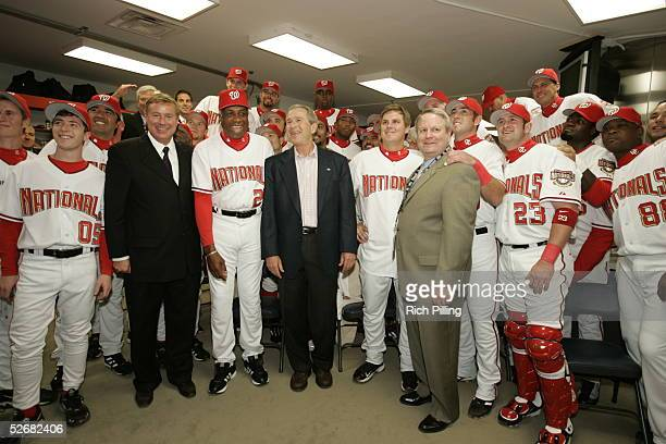 President George W Bush poses for a group portrait with members of the Washington Nationals before the Nationals 2005 home opener against the Arizona...
