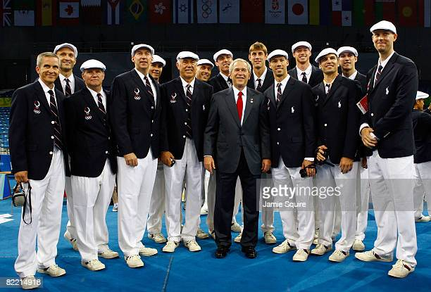 President George W Bush poses for a photo with the United States men's volleyball team during a visit by the President on the opening day of the...