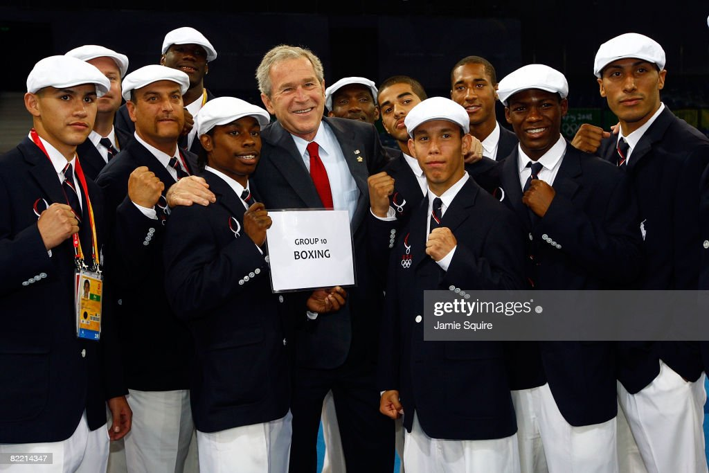US President George W. Bush poses for a photo with the United States Olympic boxing team during a visit by the President on the opening day of the Beijing 2008 Olympic Games on August 8, 2008 in Beijing, China.