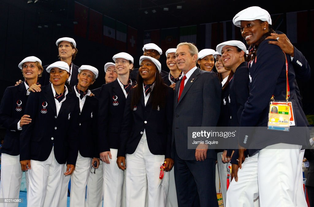 US President George W. Bush poses for a photo with the USA women's Olympic basketball team on the opening day of the Beijing 2008 Olympic Games on August 8, 2008 in Beijing, China.
