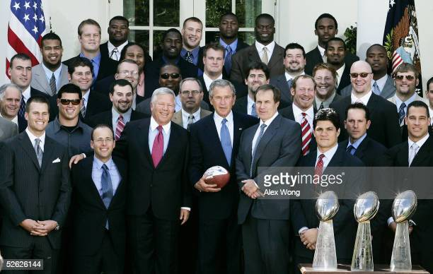 S President George W Bush poses for photographers with members of New England Patriots during a Rose Garden event to honor the Super Bowl Champions...