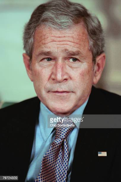 US President George W Bush poses for photographs during a meeting with President of Mali Amadou Toumani Toure in the Oval Office at the Whtie House...