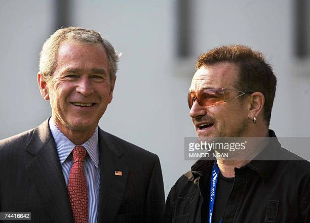 President George W Bush poses with Irish environmental activist and U2 lead singer Bono 06 June 2007 before a meeting at the on the Baltic Sea resort...