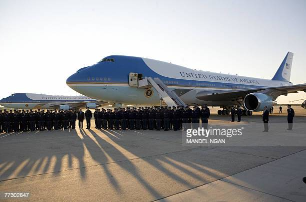 US President George W Bush poses with members of the Presidential Air Group who worked on refitting one of the presidential planes 12 October 2007 at...