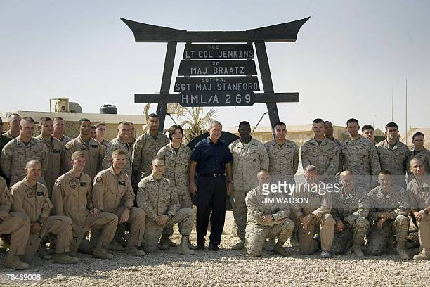 US President George W Bush poses with US Marines as he tours AlAsad Air Base in Anbar Province Iraq 03 September 2007 Bush paid a surprise visit to...
