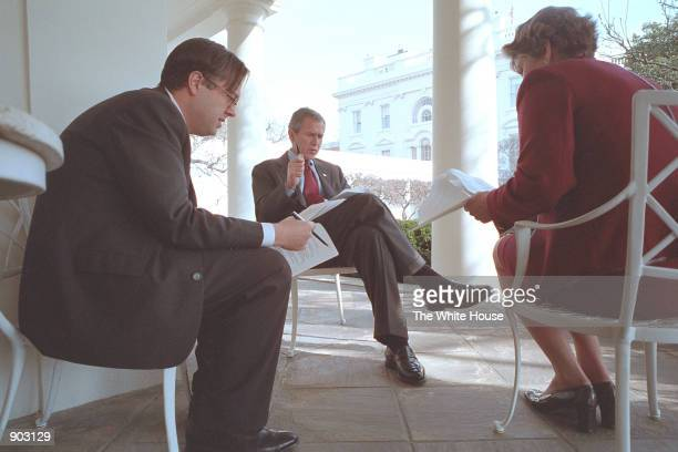 President George W Bush prepares for his State of the Union Speech with Karen Hughes Counselor to the President and Michael Gerson Director of...