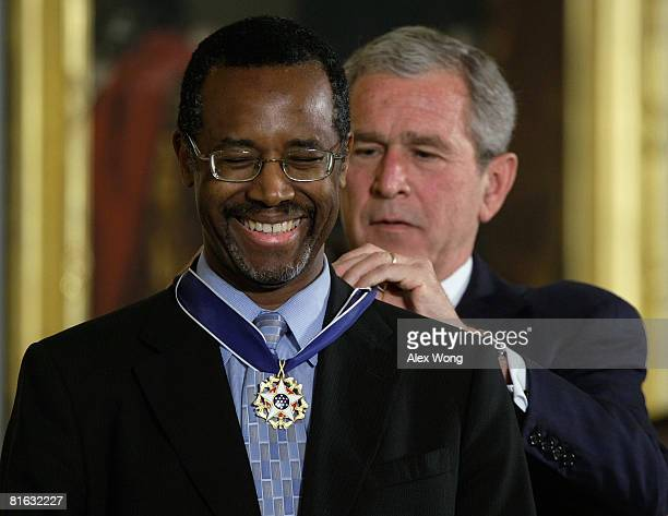 S President George W Bush presents a Presidential Medal of Freedom to Benjamin S Carson Sr MD for his work withneurological disorders during an East...
