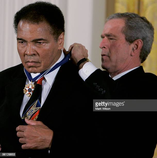 S President George W Bush presents former heavy weight boxing champion Muhammad Ali with the Medal of Freedom during a ceremony during a ceremony in...