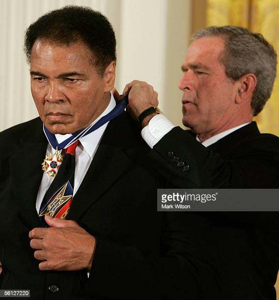 S President George W Bush presents former heavy weight boxing champion Muhammad Ali with the Medal of Freedom during a ceremony in the East Room of...