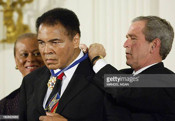 US President George W Bush presents the Presidential Medal of Freedom the nation's highest civil awardto boxer Muhammad Ali in the East Room of the...