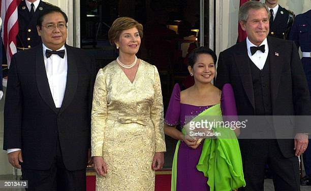 President George W. Bush, President of the Republic of the Philippines Gloria Macapagal-Arroyo, First Lady Laura Bush, and Jose Miguel T. Arroyo are...