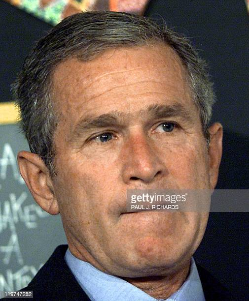 US President George W Bush reacts at a school event 11 Sept 2001 in Saratota Florida moments after being informed by his Chief of Staff Andrew Card...