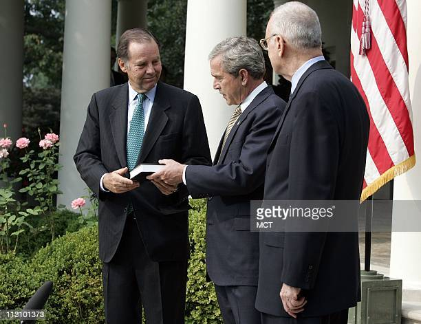 WASHINGTON DC President George W Bush receives the 9/11 Commission final report from 9/11 Commission Chairman Thomas H Kean and Vice Chairman Lee H...