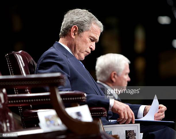 US President George W Bush reviews his notes before speaking during the Military Appreciation Parade at Fort Myer January 6 2009 in Arlington...