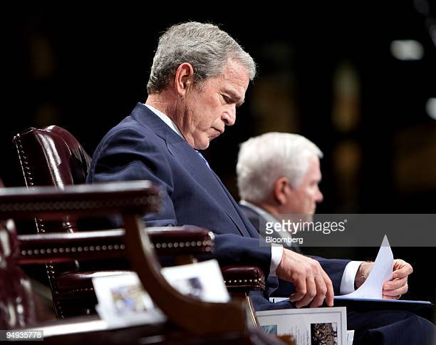 S President George W Bush reviews his notes before speaking to the Military Appreciation Parade at Fort Myer in Arlington Virginia US on Tuesday Jan...