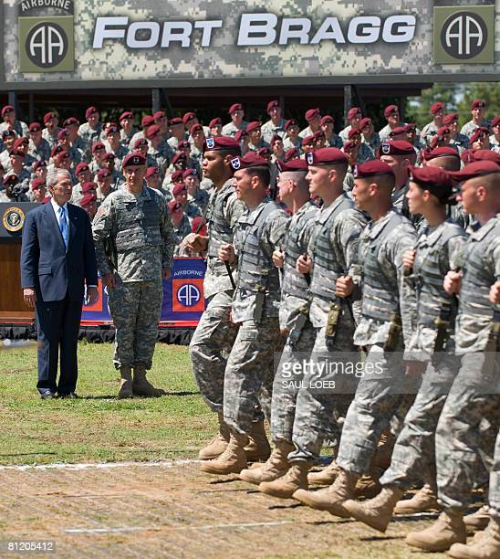 US President George W Bush reviews troops alongside Major General David Rodriguez during a Division Review Ceremony for the 82nd Airborne at Fort...