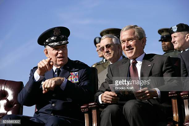 President George W. Bush, right, participates in the Armed Forces Farewell Tribute in Honor of General Richard B. Myers, left, and Armed Forces Hail...