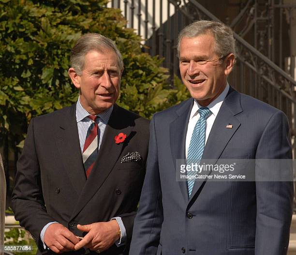 President George W Bush right shares a momnet with Britain's Prince Charles left upon the arrival of Prince Charles and his wife Camilla Duchess of...
