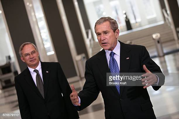 US President George W Bush right talks to reporters after he received an intelligence briefing at CIA Headquarters in Langley Va near Washington...