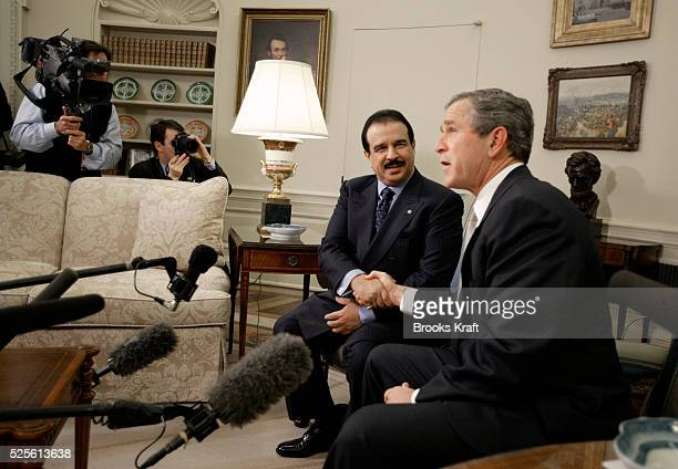 US President George W Bush shakes hands with Bahrain's King Hamad bin Isa al Khalifa in the Oval Office of the White House The Persian Gulf Arab...
