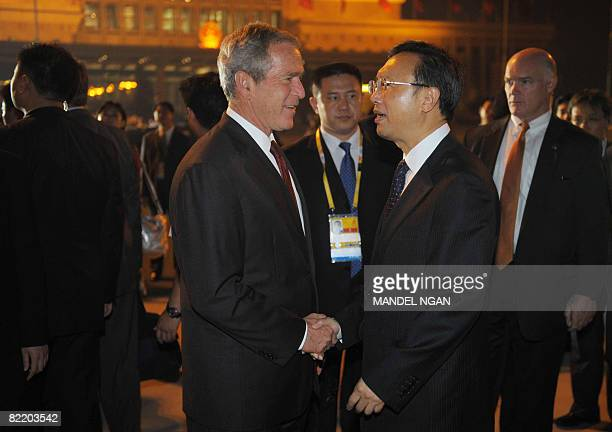 President George W. Bush shakes hands with Chinese Foreign Minister Yang Jiechi upon his arrival on August 7, 2008 at Beijing Capital International...
