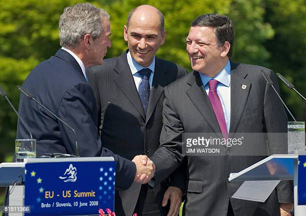 President George W. Bush shakes hands with European Union Commission President Jose Manuel Barroso alongside Slovenian Prime Minister Janez Jansa at...