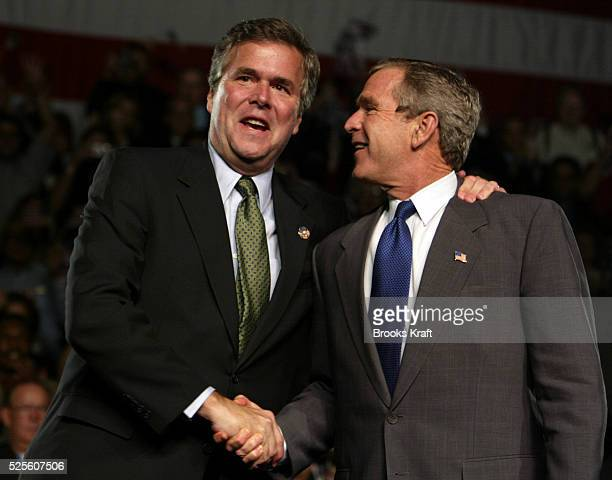 President George W Bush shakes hands with his brother Florida governor Jeb Bush