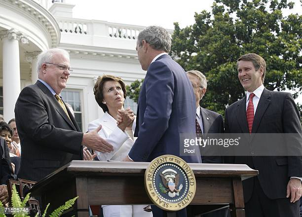 US President George W Bush shakes hands with House Minority Leader Nancy Pelosi after signing the HR 9 the Fannie Lou Hammer Rosa Parks and Coretta...