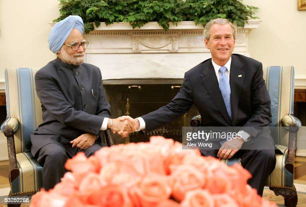 President George W. Bush shakes hands with Indian Prime Minister Manmohan Singh during their meeting July 18, 2005 at the Oval Office of the White...