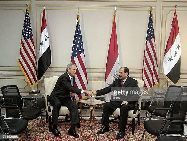 President George W Bush shakes hands with Iraqi Prime Minister Nuri alMaliki during their meeting on June 13 2006 in Baghdad Iraq Bush told Maliki...
