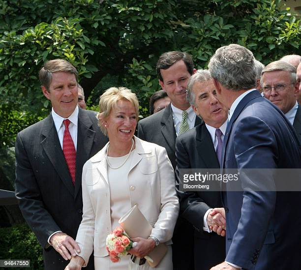 President George W Bush shakes hands with John Walsh after signing the Adam Walsh Child Protection and Safety Act of 2006 in the Rose Garden at the...