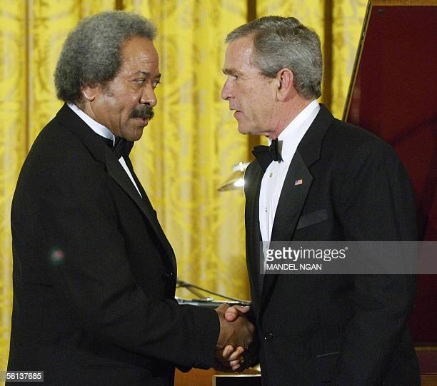 President George W. Bush shakes hands with musician Allen Toussaint of New Orleans after his performance following a dinner celebrating the 40th...