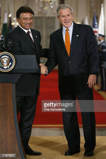 S President George W Bush shakes hands with Pakistan President Pervez Musharraf after a joint press conference in the East Room of the White House...